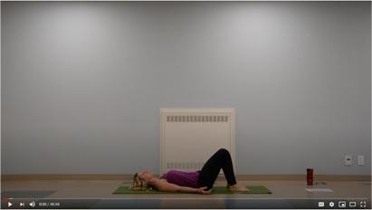 video screenshot of instrucot doing yoga