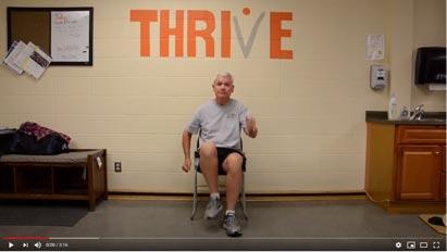 video screenshot of man exercising on chair