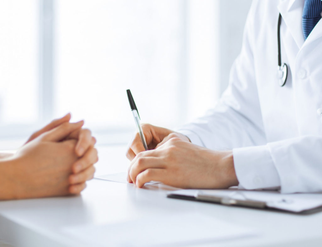 Close,Up,Of,Patient,And,Doctor,Taking,Notes